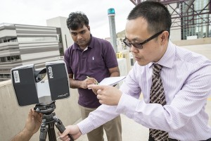 Assistant Professor Pingbo Tang (right) will use sophisticated imaging technology in the research project he will lead to help improve nuclear power facility operations. Photographer: Jessica Hochreiter/ASU