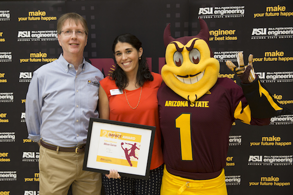Dean Kyle Squires and Sparky stand with Fulton Difference Award winner Allison Curran.