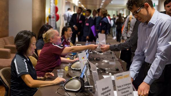 Staff volunteers help students at Career Fair.