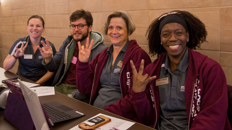 Fulton Schools staff volunteers pose at Career Fair