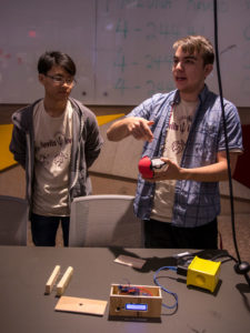 Two students present their prototype at a Devils Invent event.