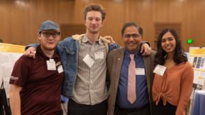 Sandeep Gupta poses with his FURI students